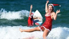 Santa Claud, Or Claudia Mather, gets right In The Christmas spirit