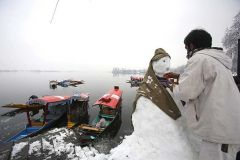 A Kashmiri Muslim boat Men make A snowman To attract customers