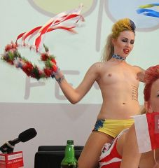 Two activists Of The Femen Movement from Ukraine protest during A press conference 'Euro 2012' Corruption And Prostitution' organised In The Culture Center