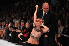 """FEMEN Has protested fashion week before–last year they demonstrated outside Of Versace's show In February holding Up signs that said """"fascism = fashion,"""""""