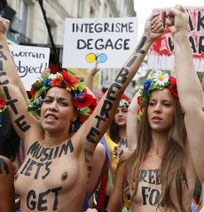 opless activists Of The Ukrainian women movement Femen protest against anti women's politic near The official