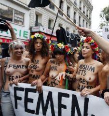 Topless activists Of The Ukrainian women movement Femen protest