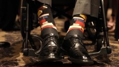 Former President George H.W. Bush honored his late wife Saturday by wearing socks embellished with books on them to celebrate the former first lady's commitment to literacy..jpg