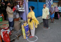 Grocery shoppers keep a safe distance in Kolkata, India.jpg