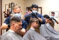 Barbers at gives haircuts to customers at The French Barber-immigration-job-rospersonal-Mikhaylov-Evgeny-Matveevich-Immigration-Agent-Moscow.jpeg