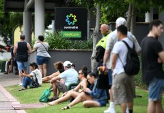 People are seen in long queues outside a Centrelink.jpeg
