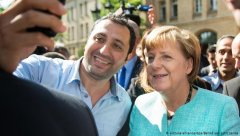 Refugee in Berlin taking selfie with Angela Merkelvisa-news-rospersonal-Mikhaylov-Evgeny-Matveevich-Immigration-Agent-Moscow.jpg